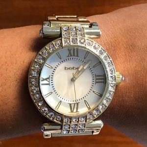bebe gold embellished watch.